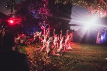 Aya Serpent 2015 dancers in garden with hands up