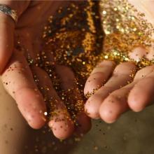 Hands holding glitter