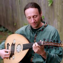 Derek Wright playing the oud